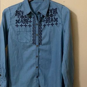 Faded denim blouse with embroidery